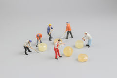 Mini of painters of workers with candy Stock Photography