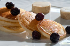 MIni pancakes with blueberries Stock Images