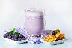 Mini pancakes with fresh blueberries Stock Image