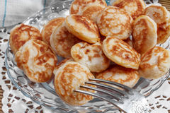 Mini pancakes on a plate Royalty Free Stock Image