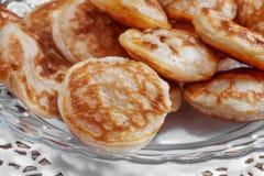 Mini pancakes on a plate Royalty Free Stock Photos