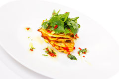 Mini pancakes with rocket salad Stock Photography
