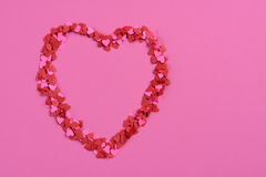 Mini Paper Hearts on Pink Stock Photography