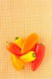 Mini paprika on a checkered dish towel Royalty Free Stock Photo