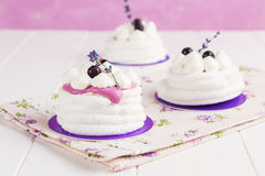 Mini pavlova with black currant and lavender Royalty Free Stock Images