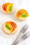Mini Peach Cheesecake Arkivbilder