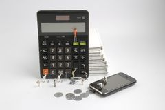 mini  people figure standing on clearing  calculator Royalty Free Stock Photos
