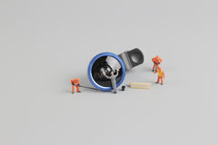 Mini people worker cleaning camera len Stock Photography