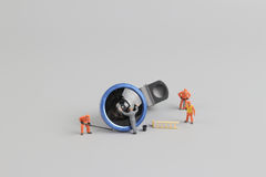 Mini people worker cleaning camera len Royalty Free Stock Photos