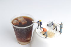 Mini people workers with cup of soft drink. The Mini people workers with cup of soft drink Royalty Free Stock Photos
