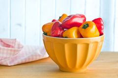 Mini peppers in bowl Stock Image