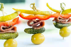 Mini pickled sweet pepper and anchovy appetizer. Royalty Free Stock Photo
