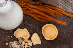 Mini pie apple with crumb and bottle of milk , top view. Royalty Free Stock Photo