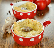 Mini pie with cheese and mushrooms Stock Image