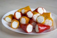 Mini pimientas rellenas con queso Imagen de archivo libre de regalías