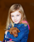 Mini pinnscher puppy mascot with blond kid girl Royalty Free Stock Photo