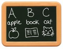 Mini pizarra del niño - A está para Apple? Imagen de archivo libre de regalías
