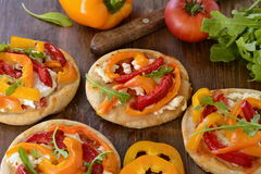Mini pizza with bell pepper, cottage cheese, herbs stock image