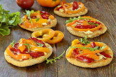 Mini pizza with bell pepper, cottage cheese, herbs royalty free stock photos
