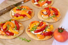 Mini pizza with bell pepper, cottage cheese, herbs stock photos
