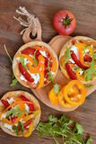 Mini pizza with bell pepper, cottage cheese and herbs stock photo