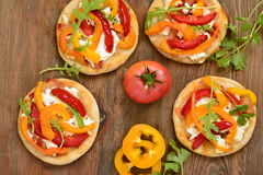 Mini pizza with bell pepper, cottage cheese and herbs royalty free stock image