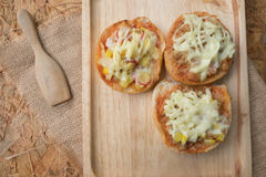 Mini pizza buns topped with mayonnaise sauce Stock Photo