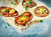 Mini pizza with cheese and tomato Royalty Free Stock Images