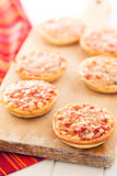 Mini pizza on cutting board Royalty Free Stock Photography