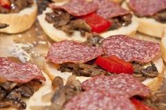 Mini pizza loaves. Close up photo of tasty mini pizza loves royalty free stock photos