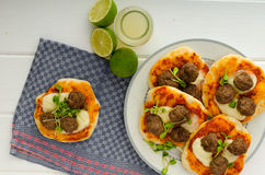 Mini pizza with meatballs Royalty Free Stock Photography
