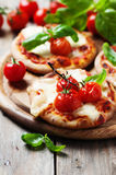 Mini pizza with mozzarella and tomato Stock Images