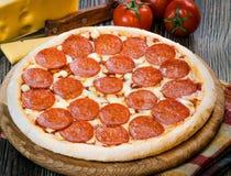 Mini pizza pepperoni. Mini pepperoni pizza on the table Royalty Free Stock Image