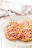 Mini pizza on plate Royalty Free Stock Images