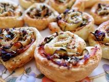 Mini pizza rolls parma ham vegetables. Mini pizza rolls parma ham and vegetables Royalty Free Stock Image