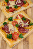 Mini pizza with salami Stock Photography