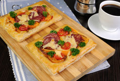 Mini pizza with salami. Mini pizza with vegetables, salami and cheese Stock Photos