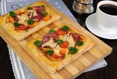 Mini pizza with salami Stock Photos