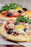 Mini pizza. With sausage and egg and arugula  for breakfast Stock Images