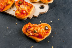 Mini pizza for Valentine`s Day Royalty Free Stock Photo