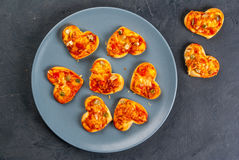 Mini pizza for Valentine`s Day Royalty Free Stock Photography