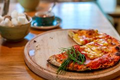 Mini pizza on wooden backing stock photo