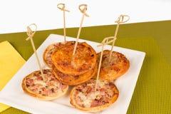 Mini pizzas Stock Photography