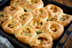 Mini pizzas baked stuffed with cheese royalty free stock images