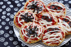 Mini pizzas decorated for a Halloween Stock Photo