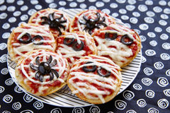 Mini pizzas decorated for a Halloween Royalty Free Stock Photos