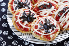 Mini pizzas decorated for a Halloween Stock Photos