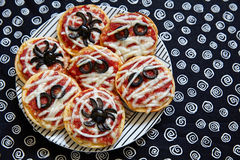 Mini pizzas decorated for a Halloween Royalty Free Stock Image