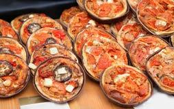 Mini pizzas Stock Images
