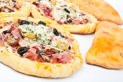 Mini Pizzas with Ham and Olives Stock Image